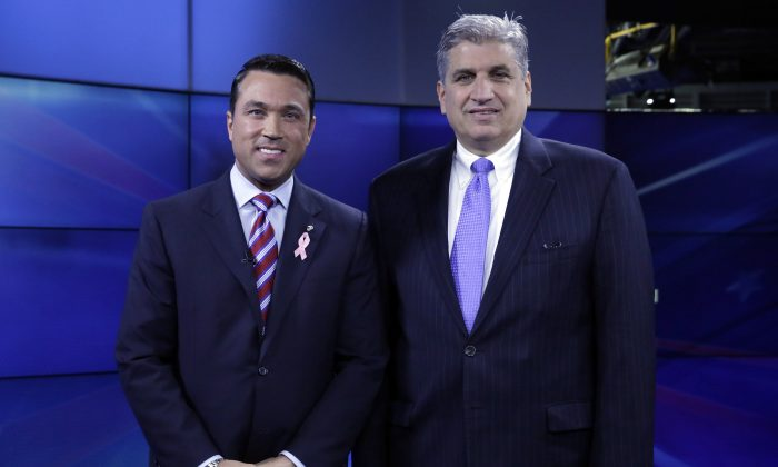 Incumbent Republican Rep. Michael Grimm (L) and Democratic challenger Domenic Recchia, pose for a photo before a recorded, televised debate for the 11th Congressional District race at WABC-TV in New York, Friday, Oct. 17, 2014,. (AP Photo/Richard Drew)