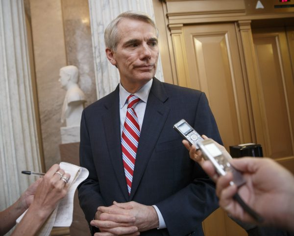 """Sen. Rob Portman, R-Ohio speaks to reporters on Capitol Hill in Washington on May 12, 2014. With Republican control of the House and Senate tantalizingly close on Nov. 4, 2014, leading Republicans are turning to a matter often overlooked in campaigns: how to actually govern. """"It's very possible to get a number of things done if the president is willing to come to the table, and I believe he will,"""" says Portman. (AP Photo/File)"""