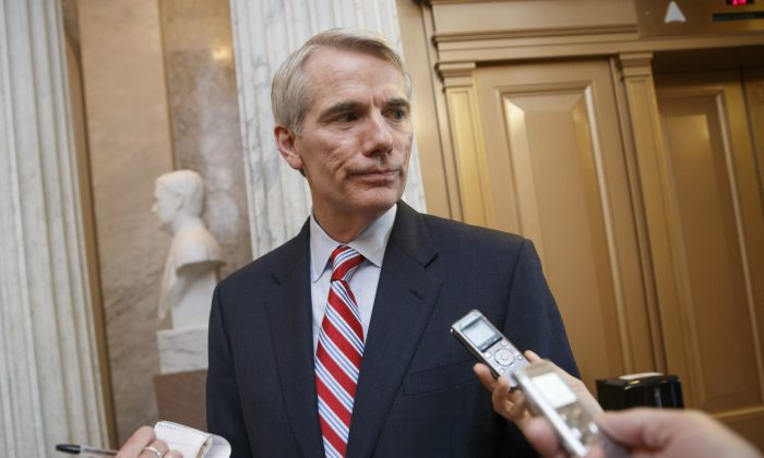 Sen. Rob Portman, (R-Ohio) speaks to reporters on Capitol Hill in Washington, on May 12, 2014. (AP Photo)