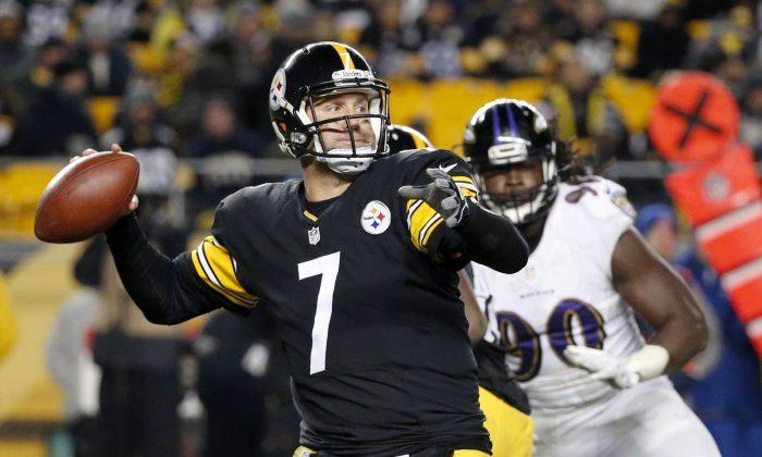 Pittsburgh Steelers quarterback Ben Roethlisberger (7) passes as Baltimore Ravens linebacker Pernell McPhee (90) pressures in the fourth quarter of an NFL football game against the Baltimore Ravens, Sunday, Nov. 2, 2014, in Pittsburgh. (AP Photo/Gene Puskar)