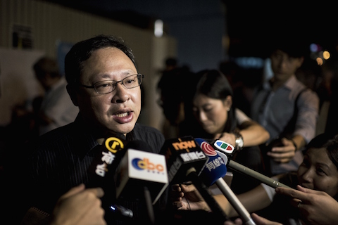 Activist Benny Tai, co-founder of the Occupy Central movement, speaks to the media at a protest outside government offices in Hong Kong on August 29, 2014. Demonstrators gathered on August 29 to urge universal suffrage in Hong Kong, as the top committee of China's legislature meets in Beijing to discuss political reforms in the southern city. (Alex Ogle/AFP/Getty Images)
