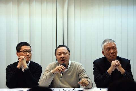 Pro-democracy activists Benny Tai (C) attends a press conference with Chan Kin-man (L) and Chu Yiu-ming (R) in Hong Kong on Dec. 2, 2014. (Johannes Eisele/AFP/Getty Images)