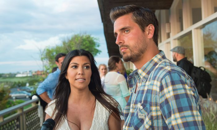 "Scott Disick and Kourtney Kardashian attend the ""Party Under The Stars"" benefit hosted by Women's Health and Feed at the Bridgehampton Tennis and Surf Club on Saturday, Aug. 9, 2014 in New York. (Photo by Scott Roth/Invision/AP)"