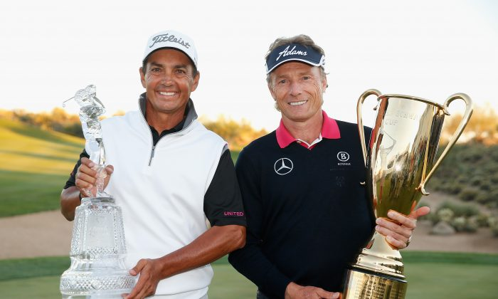 Tom Pernice Jr., with the Charles Schwab Cup Championship trophy, and Bernhard Langer of Germany, with the Charles Schwab Cup, pose together following the final round of the Charles Schwab Cup Championship on the Cochise Course at The Desert Mountain Club on November 2, 2014 in Scottsdale, Arizona. (Christian Petersen/Getty Images)