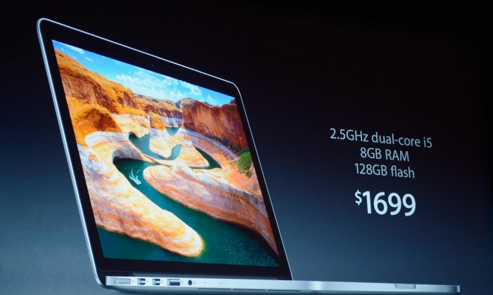 The price of a new 13-inch MacBook Pro is dirplayed during an Apple special event at the historic California Theater on October 23, 2012 in San Jose, California. (Kevork Djansezian/Getty Images)