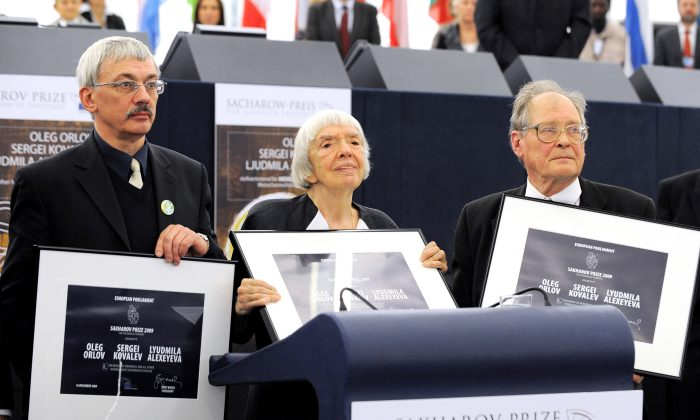 "Members of Russian historical and human rights organization ""Memorial"" (L-R) Oleg Orlov, Lyudmila Alexeyeva, and Sergei Kovalev receive the 2009 Sakharov Prize for Freedom of Thought at the European Parliament in Strasbourg, France on Dec. 16. (Johanna Leguerre/AFP/Getty Images)"