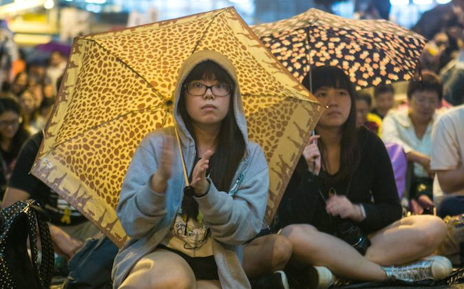 Pro-democracy protesters attend a rally marking one month of protests at the Central District in Hong Kong on Oct. 28, 2014. (Benjamin Chasteen/Epoch Times)
