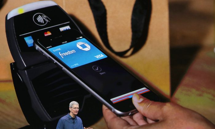 Apple CEO Tim Cook speaks during an Apple special event at the Flint Center for the Performing Arts on September 9, 2014 in Cupertino, California. Apple unveiled the Apple Watch wearable tech and two new iPhones, the iPhone 6 and iPhone 6 Plus. (Justin Sullivan/Getty Images)