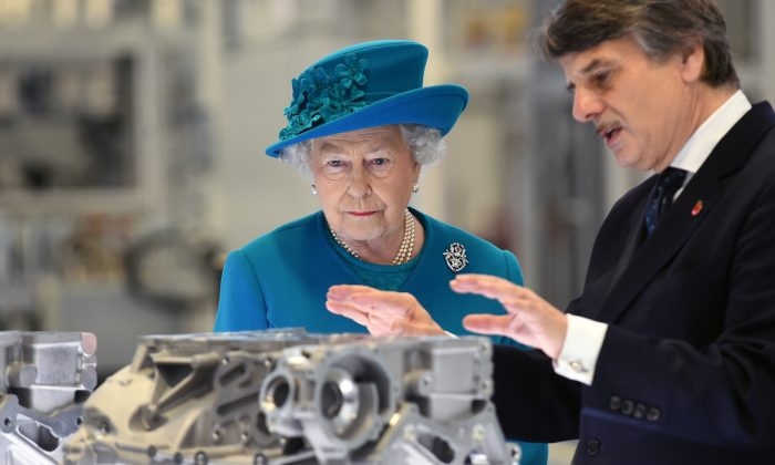 Queen Elizabeth II is shown engine parts by chief executive Dr Ralf Speth (R) during a tour of the new Jaguar Land Rover Engine Manufacturing Centre in Wolverhampton on October 30, 2014 in Wolverhampton. (Photo by Joe Giddens - WPA Pool/Getty Images)