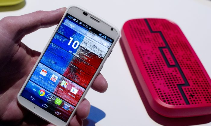 The Motorola Moto X smartphone, using Google's Android software, is displayed, Aug. 1, 2013 at a press preview in New York. (AP Photo/Mark Lennihan)