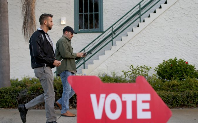 Eric Barenz (L) and David Dean prepare to vote at The Coliseum where a polling station is setup on November 4, 2014 in St Petersburg, United States.