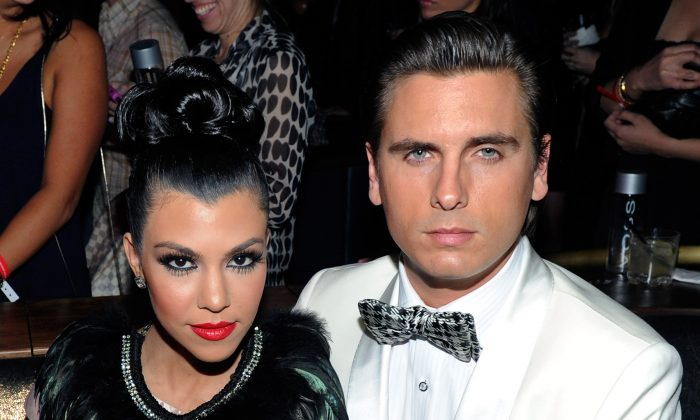 Television personalities Kourtney Kardashian (L) and Scott Disick attend the launch of AG Adriano Goldschmied's 'backstAGe presents:' initiative featuring The Black Keys at the Marquee Nightclub at the Cosmopolitan of Las Vegas February 14, 2011 in Las Vegas, Nevada. (Photo by Ethan Miller/Getty Images for AG Adriano Goldschmied)