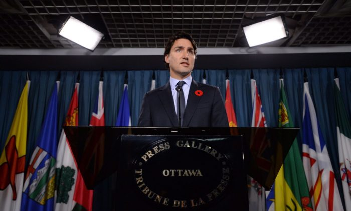 Liberal Leader Justin Trudeau speaks at a news conference on Parliament Hill in Ottawa Wednesday, Nov. 5, 2014. Two Liberal MPs have been kicked out of their party's caucus amid accusations of personal misconduct made by two female members of the NDP. (The Canadian Press/Sean Kilpatrick)