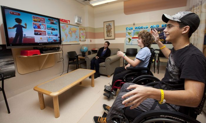 Patients at the Children's Hospital of Eastern Ontario play with a motion-tracking video game, Dec. 3, 2010. CHEO has launched a legal challenge against the U.S. patent holders of genes related to a rare heart disorder. (The Canadian Press/Sean Kilpatrick)