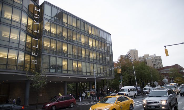 Cars pass by Manhattan's Bellevue Hospital where New York City's first ebola patient, Craig Spencer, is being treated, on Oct. 23, 2014. One person quarantined due to contact with Spencer was released this Wednesday. (AP Photo/John Minchillo)