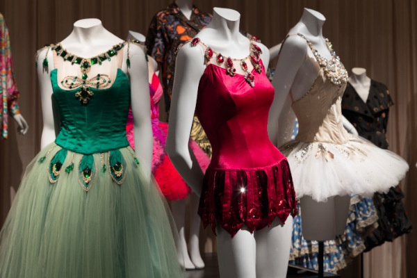 "Installation view of Dance & Fashion, featuring costumes by Barbara Karinska for New York City Ballet's ""Jewels."" (Photograph © The Museum at FIT, New York)."