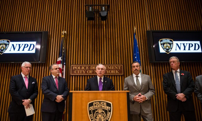 (L-R) John Miller, Deputy Commissioner of Intelligence & Counter-terrorism of the New York City Police Department (NYPD); George Venizelos, Assistant Director-in-Charge of the FBI (Federal Bureau of Investigation); NYPD Commissioner William Bratton; Charles Beck, Chief of the Los Angeles Police Department and Sir Bernard Hogan-Howe, Commissioner of the Metropolitan Police Service of London, at a press conference at the NYPD headquarters in Manhattan, on November 6, 2014. At the annual NYPD-led meeting on anti-terrorism, called Operation Sentry, both commissioners spoke of the growing threat of individuals who self-radicalize and plot attacks after viewing terrorist propaganda on the Internet. (Photo by Andrew Burton/Getty Images)