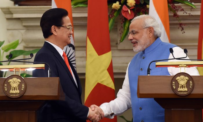 Indian Prime Minister Narendra Modi (R) shakes hands with Vietnamese Prime Minister Nguyen Tan Dung following an agreement signing in New Delhi on Oct. 28, 2014. Vietnam Prime Minister Nguyen Tan Dung has sought India's support to resolve territorial disputes in the South China Sea in a bid to shore up regional alliances as relations have soured with China. (Prakash Singh/AFP/Getty Images)