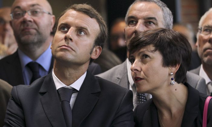 Carole Delga (R), State Secretary in charge of trade, crafts, consumption, and social and solidary economy, is sitting besides Emmanuel Macron (L), Minister of Economy. (Charly Triballeau/AFP/Getty Images)