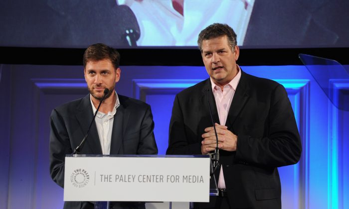 ESPN hosts Mike Greenberg (L) and Mike Golic speak on stage at the Paley Prize Gala honoring ESPN's 35th anniversary presented by Roc Nation Sports on May 28, 2014 in New York City. (Photo by Bryan Bedder/Getty Images for Paley Center for Media)