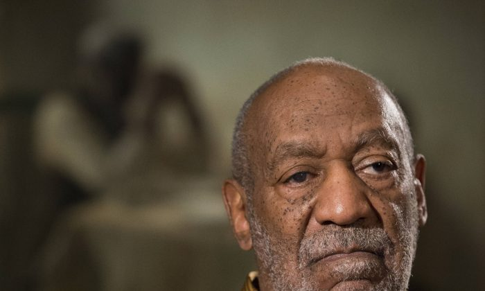 "Raven Symone 'Files Molestation Charges Against Bill Cosby' is Fake. In this photo taken Nov. 6, 2014, entertainer Bill Cosby pauses during an interview about the upcoming exhibit, Conversations: African and African-American Artworks in Dialogue, at the Smithsonian's National Museum of African Art in Washington. The Smithsonian Institution is mounting a major showcase of African-American art and African art together in a new exhibit featuring the extensive art collection of Bill and Camille Cosby. More than 60 rarely seen African-American artworks from the Cosby collection will join 100 pieces of African art at the National Museum of African Art. The exhibit ""Conversations: African and African American Artworks in Dialogue,"" opens Sunday and will be on view through early 2016. (AP Photo/Evan Vucci)"