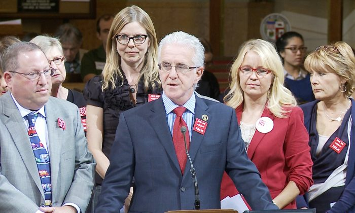 City council members Paul Koretz (L) and Paul Krekorian (R), along with and members of Women Against Gun Violence (back row), speak about the need for stricter gun laws in front of the Los Angeles City Council Meeting in Los Angeles, Calif. on Nov. 7, 2014. (Eric Zhang/Epoch Times)