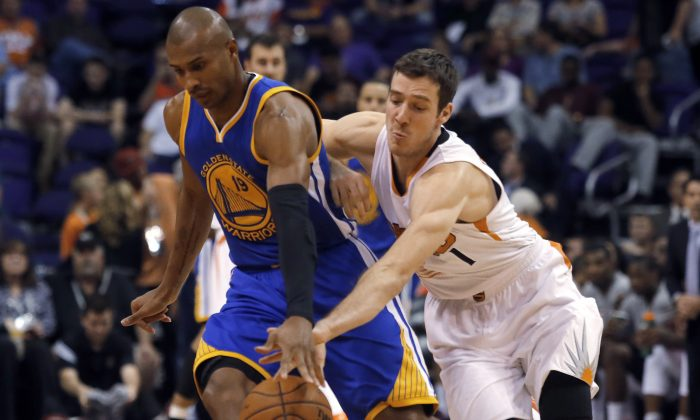Golden State Warriors guard Leandro Barbosa (19) tries to keep the ball from Phoenix Suns guard Goran Dragic (1) during the first quarter during an NBA basketball game, Sunday, Nov. 9, 2014, in Phoenix. (AP Photo/Rick Scuteri)