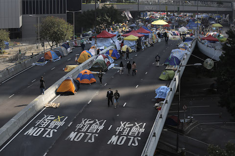 Pro-democracy protesters' tents are seen at the occupied area outside government headquarters in Hong Kong Tuesday, Dec. 9, 2014. (AP Photo/Vincent Yu)