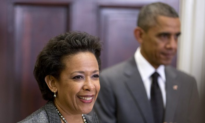 President Barack Obama listens as US Attorney Loretta Lynch speaks in the Roosevelt Room of the White House in Washington, on Saturday. The president announced he would nominate Lynch to replace Attorney General Eric Holder. (AP Photo/Carolyn Kaster)