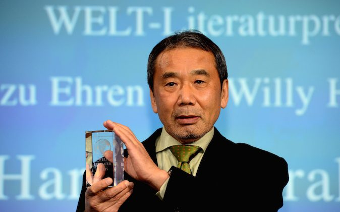 Japanese writer Haruki Murakami poses with his trophy prior to an award ceremony for the Germany's Welt Literature Prize bestowed by the German daily Die Welt, in Berlin on November 7, 2014. (John MacDougall/AFP/Getty Images)