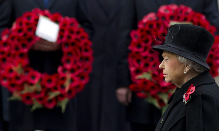 Britain's Queen Elizabeth II leads the Remembrance Sunday ceremony at the Cenotaph on Whitehall, London, on November 9, 2014. Services are held annually across Commonwealth countries during Remembrance Day to commemorate servicemen and women who have fallen in the line of duty since World War I. (AFP/Getty Images)