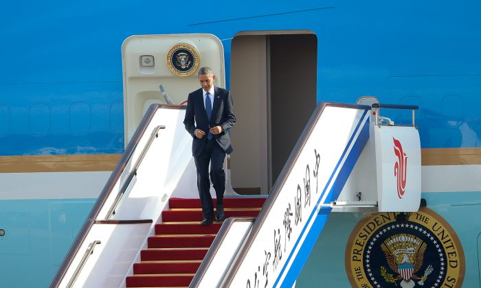 U.S. President Barack Obama arrives at the Beijing Capital International Airport on November 10, 2014 in Beijing, China. The APEC 2014 Summit will bring together leaders and senior administration from 21 countries November 7-11. (Lintao Zhang/Getty Images)