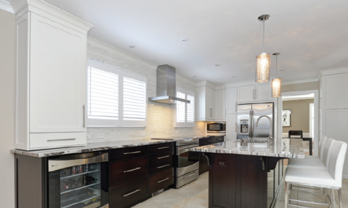 Combining both light and dark cabinets in a kitchen creates a modern, elegant style. (Courtesy of Sutcliffe Kitchens)