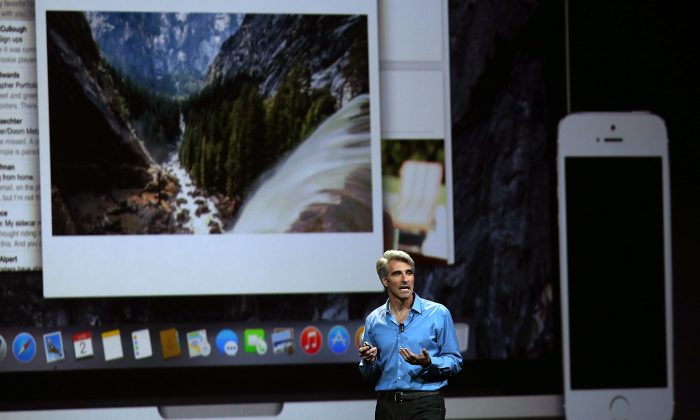 Apple Senior Vice President of Software Engineering Craig Federighi speaks during the Apple Worldwide Developers Conference at the Moscone West center on June 2, 2014 in San Francisco, Calif. (Justin Sullivan/Getty Images)