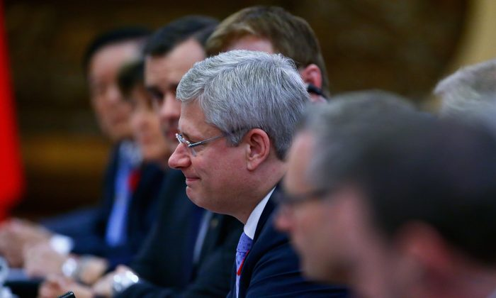 Canadian Prime Minister Stephen Harper holds meetings with Chinese President Xi Jinping  during an APAC Bilateral Meeting at the Great Hall of the People on Nov. 9, 2014 in Beijing, China. (Petar Kujundzic/Pool/Getty Images)