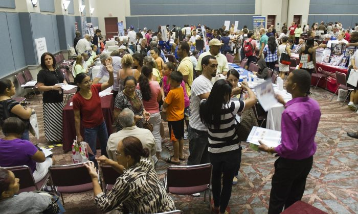 Officials from the State Department of Labor and the main casino workers' union, Local 54 of Unite-HERE, help displaced workers file for unemployment at the Atlantic City Convention Center in Atlantic City, N.J., on Sept. 3, 2014. More than 5,000 employees at the Showboat and Revel Casinos lost their jobs as both places closed this weekend. (Jessica Kourkounis/Getty Images)