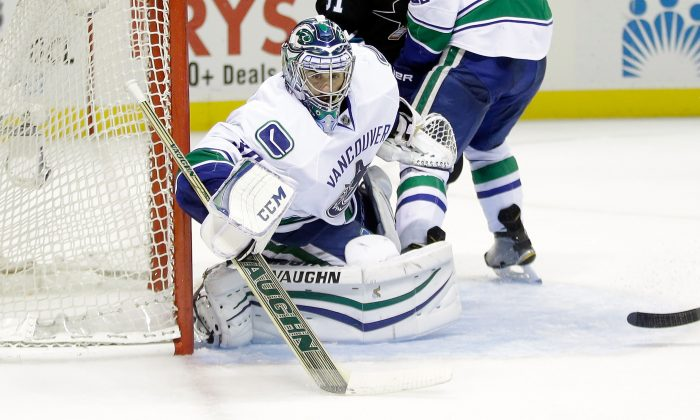 Ryan Miller of the Vancouver Canucks makes a save during their game against the San Jose Sharks at SAP Center on Nov. 6, 2014 in San Jose. The Canucks no longer have questions about their goaltending. (Ezra Shaw/Getty Images)