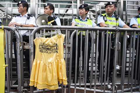 Policemen block the way to the Liaison Government Office in Hong Kong on November 9, 2014.  Hundreds of pro-democracy protesters, including leaders of a movement that that has paralysed the streets for weeks, rallied to the city's China office calling for dialogue with Beijing officials. (Xaume Olleros/AFP/Getty Images)