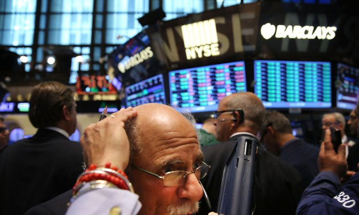 Traders work on the floor of the New York Stock Exchange in New York on July 17, 2014. Stocks fell more than 160 points on the Dow Jones Industrial Average. (Spencer Platt/Getty Images)