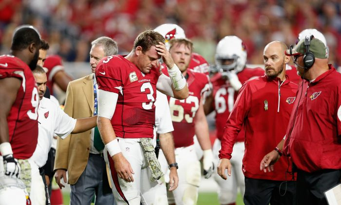 Quarterback Carson Palmer #3 of the Arizona Cardinals is helped off the field after being injured in the fourth quarter of the NFL game against the St. Louis Rams at University of Phoenix Stadium on November 9, 2014 in Glendale, Arizona. The Cardinals defeated the Rams 31-14. (Photo by Christian Petersen/Getty Images)