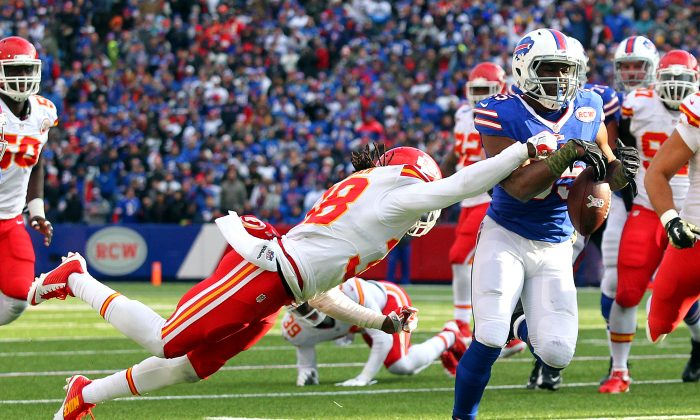 Kansas City Chiefs strong safety Ron Parker, left, forces a fumble off Buffalo Bills running back Bryce Brown during the second half of an NFL football game, Sunday, Nov. 9, 2014, in Orchard Park, N.Y. (AP Photo/Bill Wippert)
