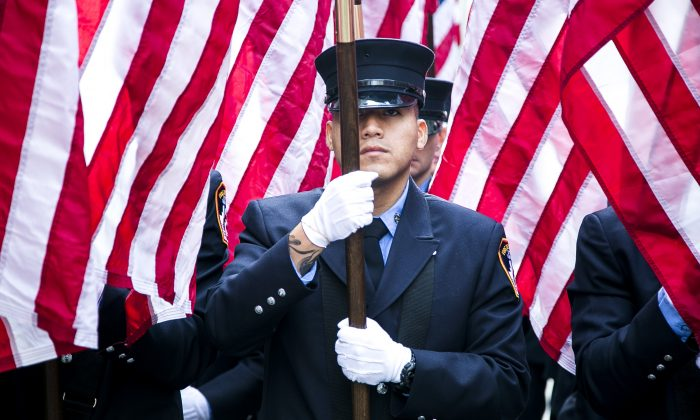 Service members march in the New York Veterans' Day Parade on Fifth Avenue, Manhattan, on Nov. 11, 2014. (Samira Bouaou/Epoch Times)
