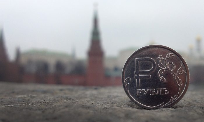A Russian ruble coin is pictured in front of the Kremlin in in central Moscow, on November 6, 2014. (Alexander Nemenov/AFP/Getty Images)