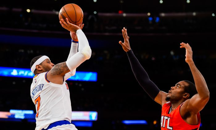 Carmelo Anthony #7 of the New York Knicks shoots over Paul Millsap #4 of the Atlanta Hawks in the first half at Madison Square Garden on November 10, 2014 in New York City. (Alex Goodlett/Getty Images)