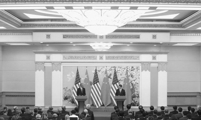"""U.S. President Barack Obama (L) and Chinese Communist Party leader Xi Jinping (R) attend a press conference at the Great Hall of People on Nov. 12, 2014 in Beijing, China. Xi Jinping said that Hong Kong's occupy movement was """"illegal."""" (Feng Li/Getty Images)"""