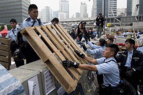 Police officers clear a wooden crate outside Hong Kong's Government complex on December 11, 2014 in Hong Kong. (Brent Lewin/Getty Images)