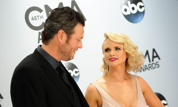 Blake Shelton and Miranda Lambert arrive at the 48th annual CMA Awards at the Bridgestone Arena on Wednesday, Nov. 5, 2014, in Nashville, Tenn. (Photo by Evan Agostini/Invision/AP)
