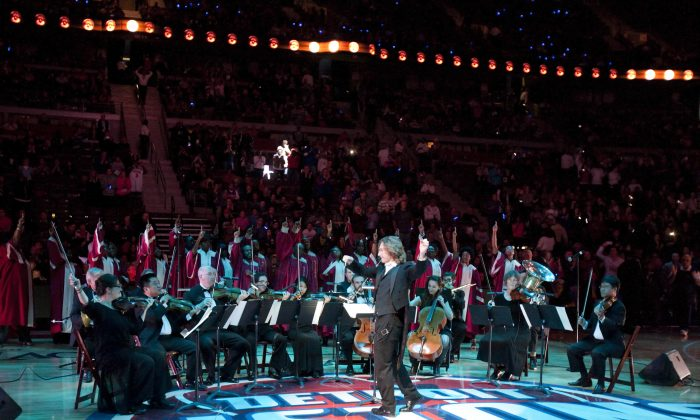 Members of the Detroit Symphony Orchestra play while the Detroit Pistons are introduced for an NBA basketball game against the Houston Rockets on Wednesday, Oct. 31, 2012, in Detroit. (AP Photo/Duane Burleson