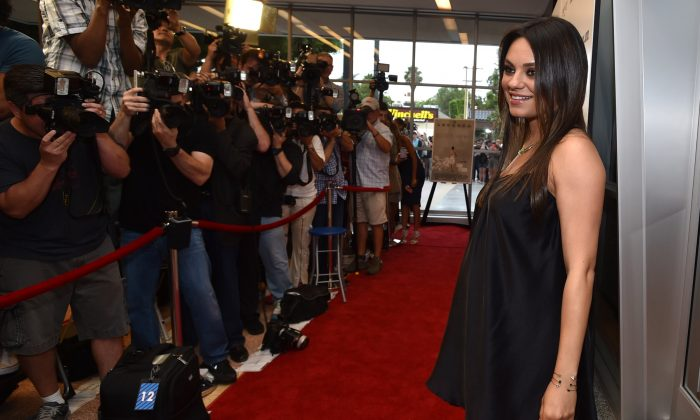 "Mila Kunis arrives at Los Angeles Premiere of ""Third Person"" on Monday, June 9, 2014, in Los Angeles. (Photo by John Shearer/Invision/AP)"