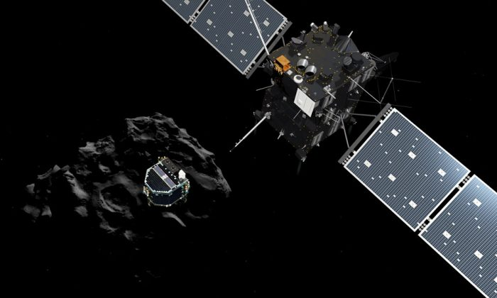 The image released by the European Space Agency ESA on Wednesday, Nov. 12, 2014, shows an artist rendering by the ATG medialab depicting lander Philae separating from Rosetta mother spaceship and descending to the surface of comet 67P/Churyumov-Gerasimenko. European Space Agency said Wednesday that the landing craft separated from Rosetta probe for descent to comet 67P. (AP Photo/ESA, ATG Medialab)